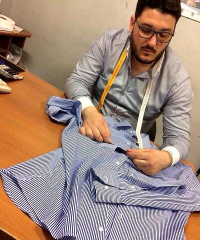 A MakersValley Italian artisan performs a quality check on garments. | MakersValley Blog