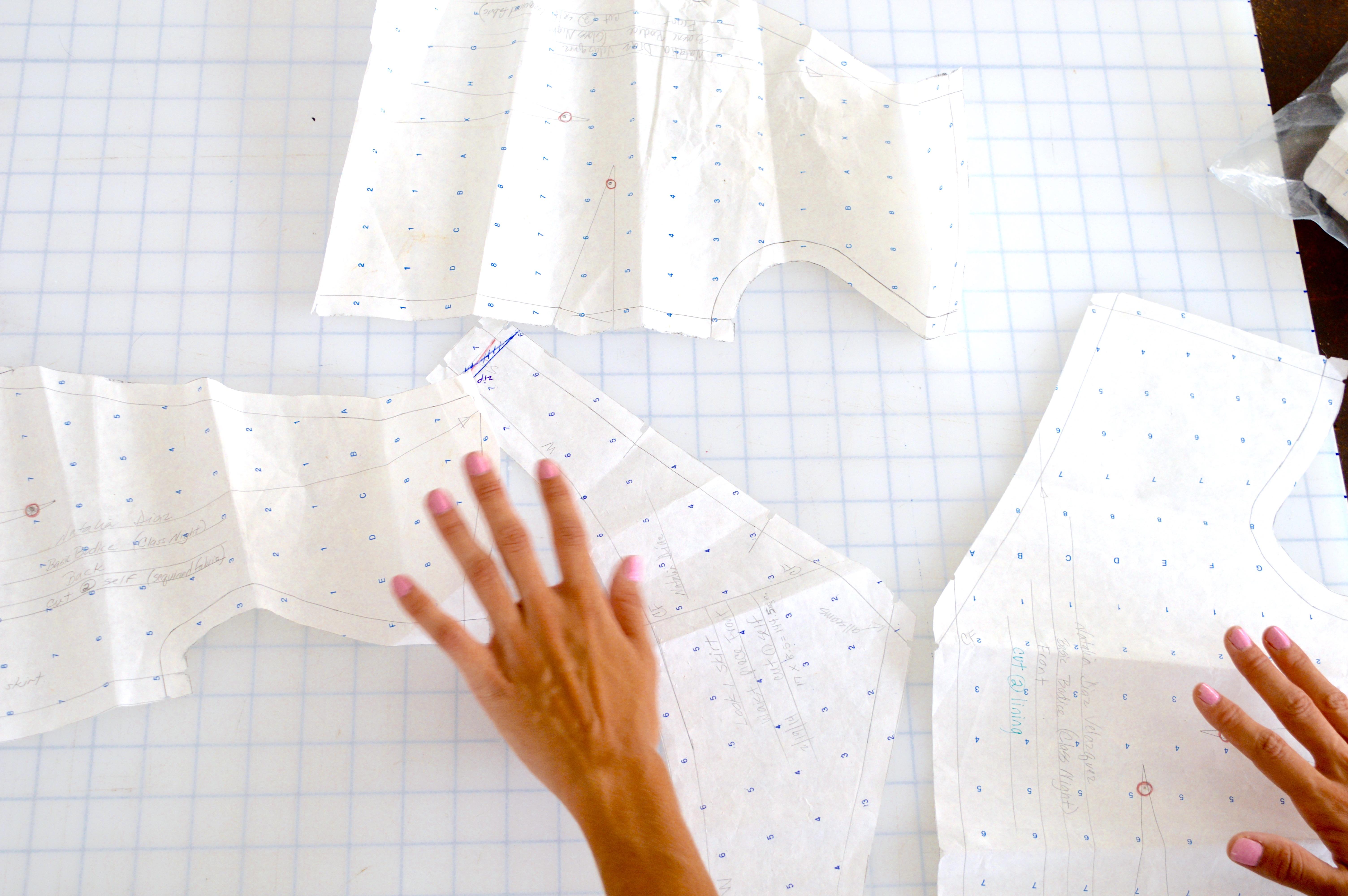 hands arranging a clothing design sample