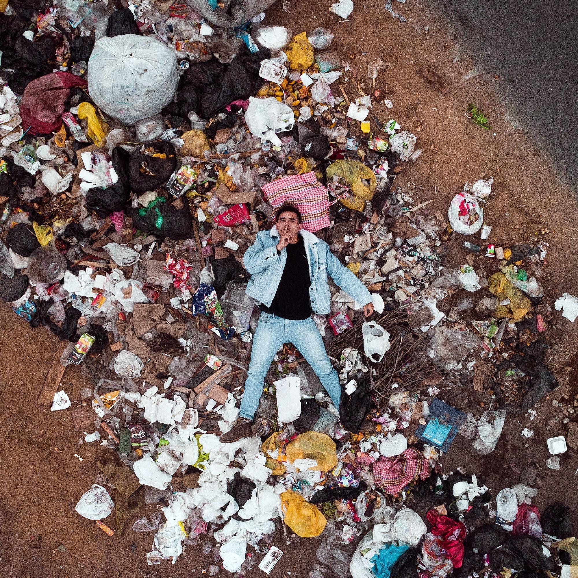 Man laying in trash