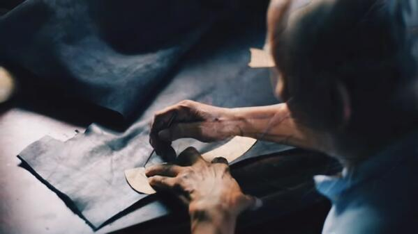 Artisan working on leather skin