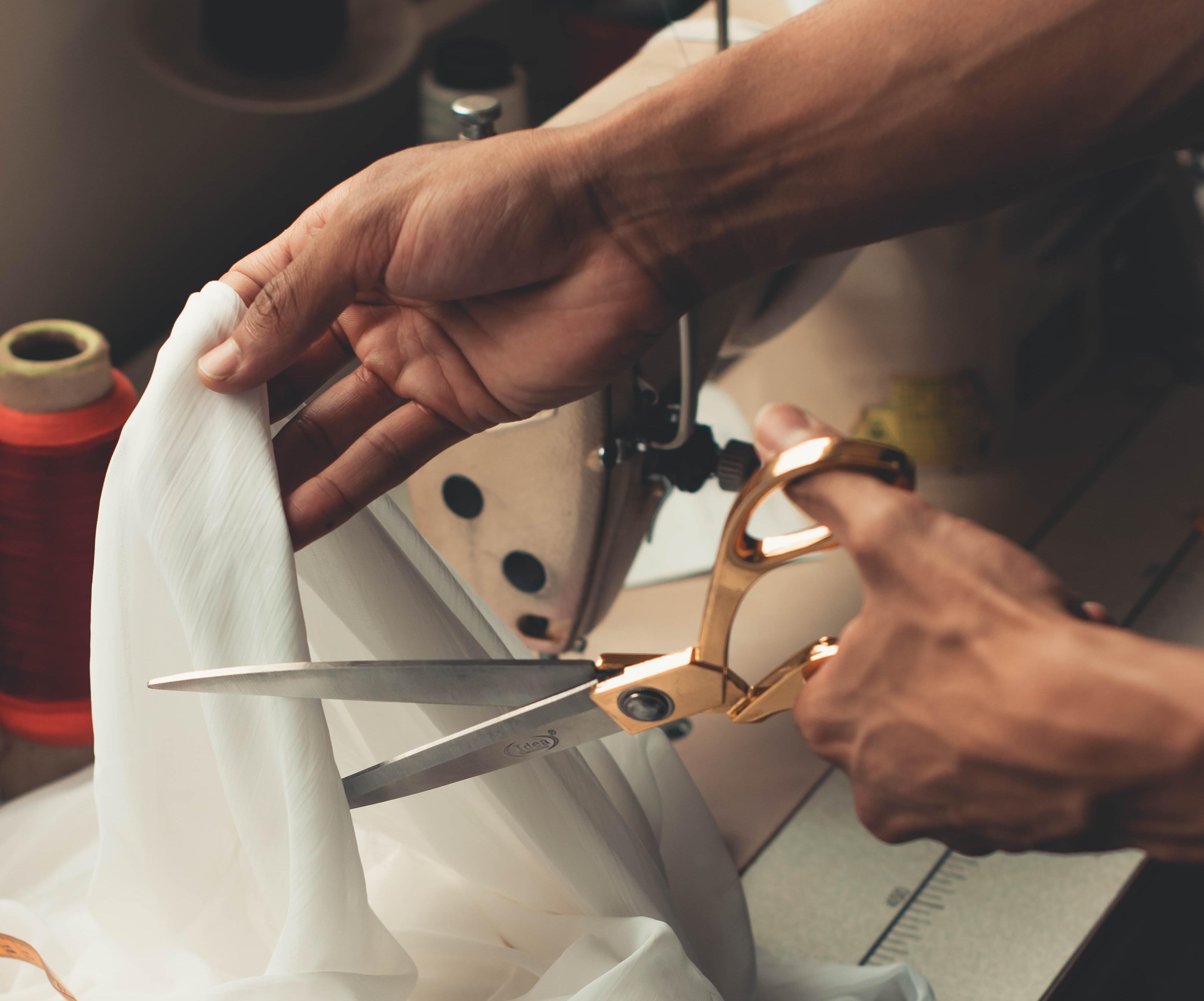 artisan cutting fabric