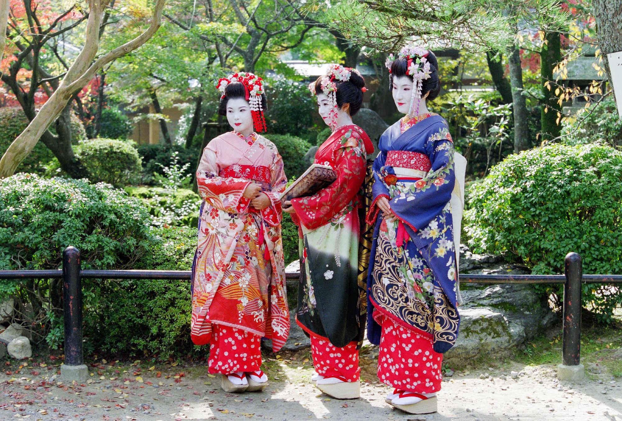 women wearing traditional kimonos and geisha makeup