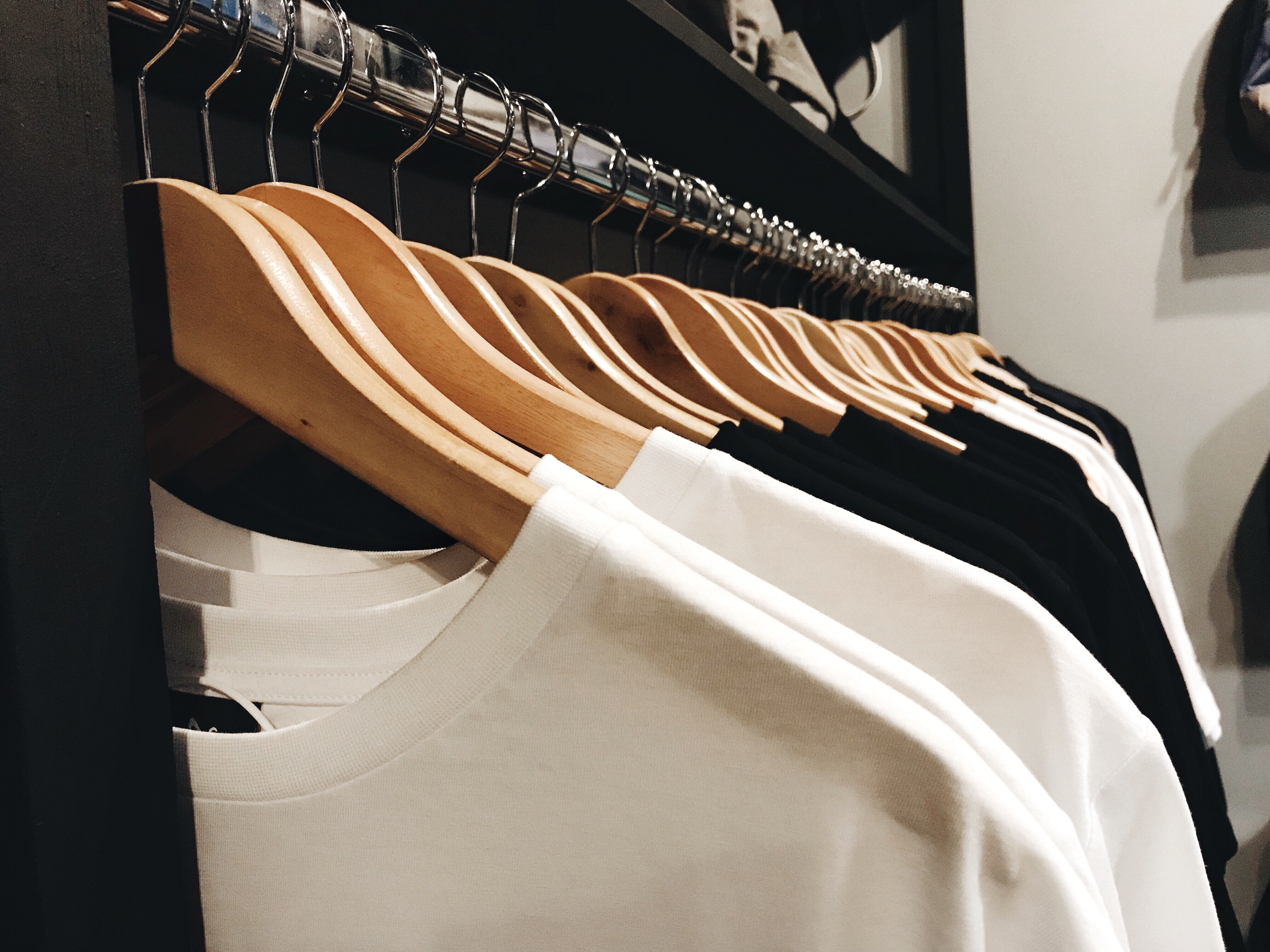 t shirts hanging on a rack