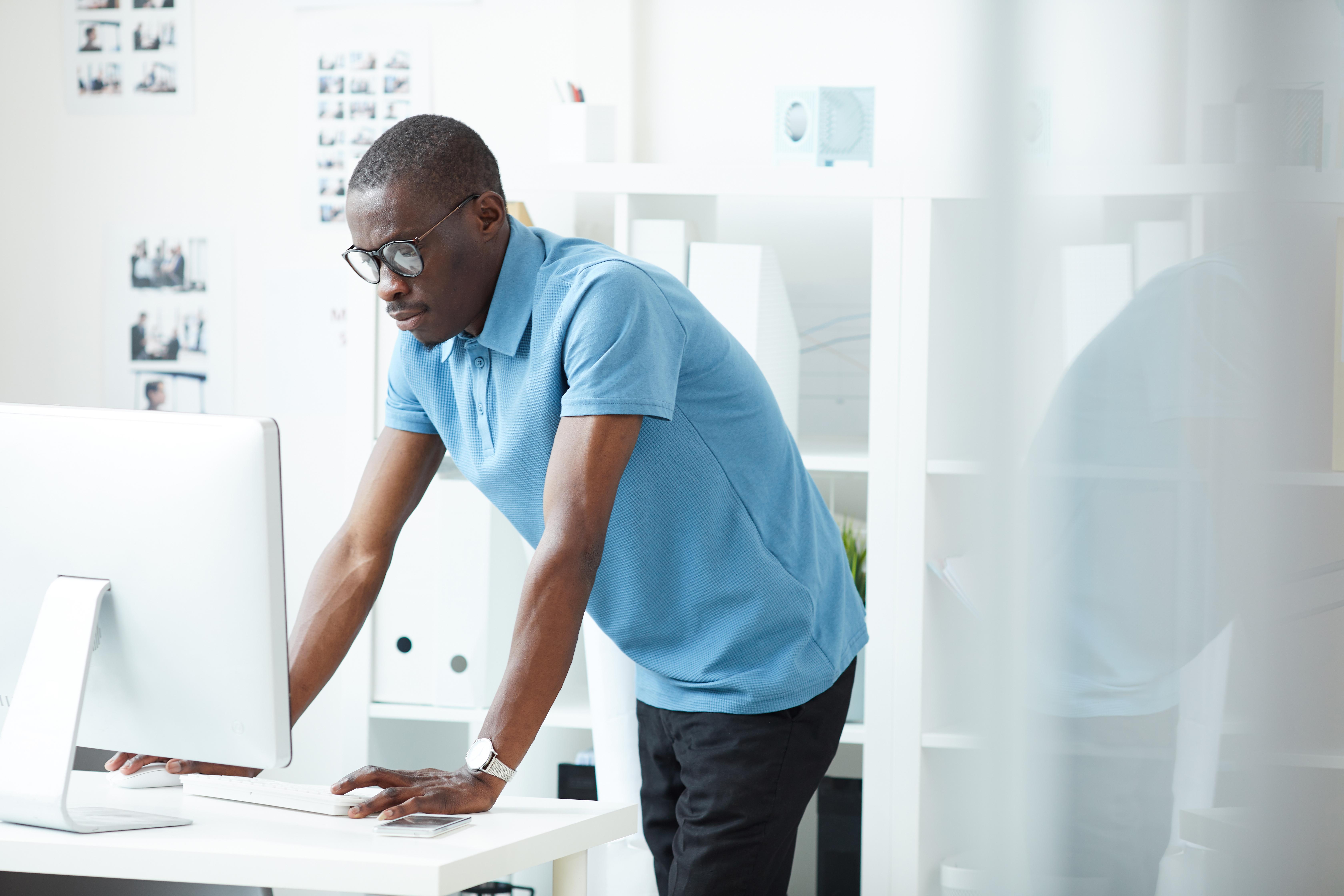 designer-using-computer-in-work-QJJJALD
