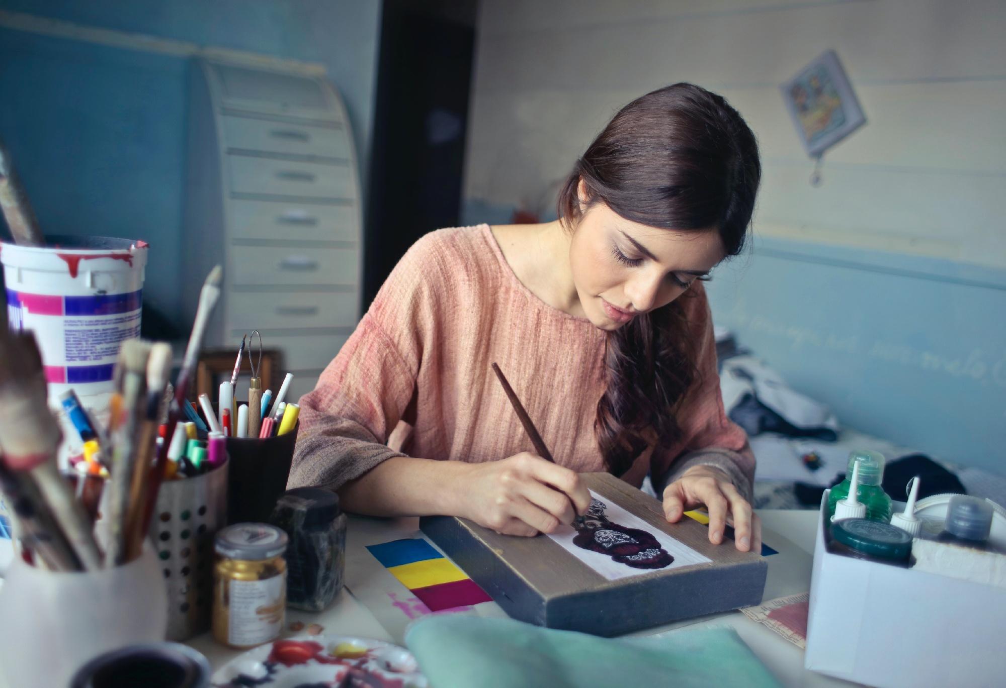 fashion designer painting a model