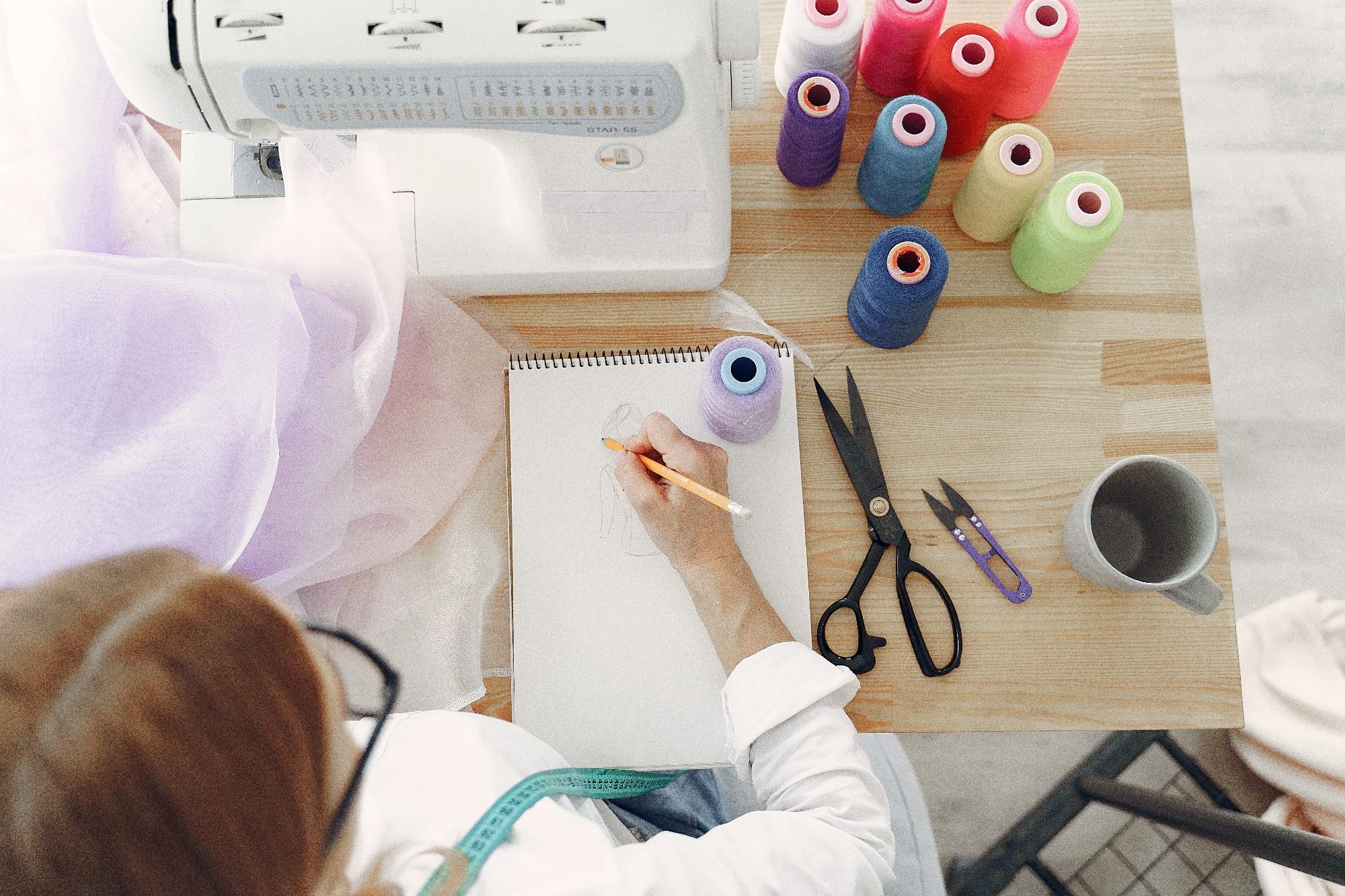woman-in-white-long-sleeve-shirt-sketching-on-white-printer-3984842-1