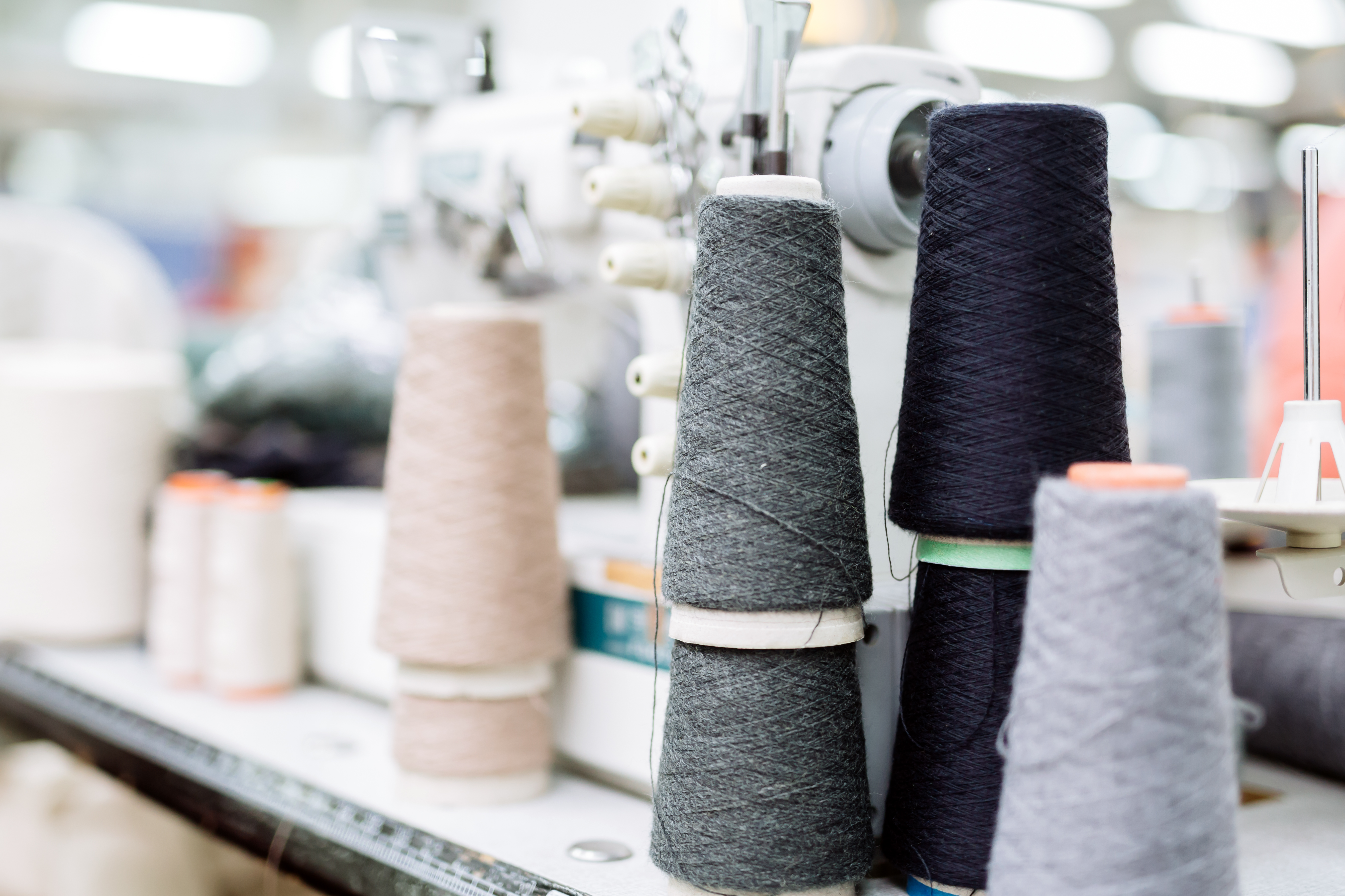 wool-and-thread-spools-on-desk-2A3L76T
